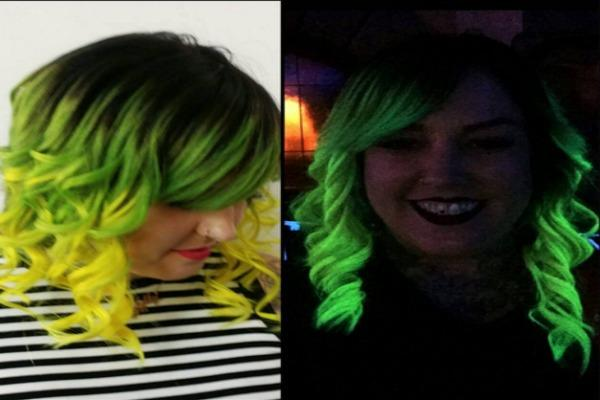 Woman with neon yellow and green hair.