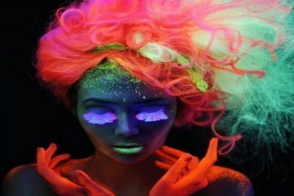 Woman with crazy neon glowing hair.