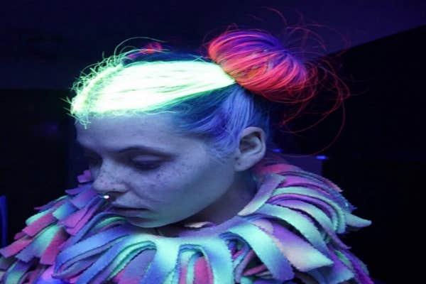 Woman with glow-in-the dark bun.