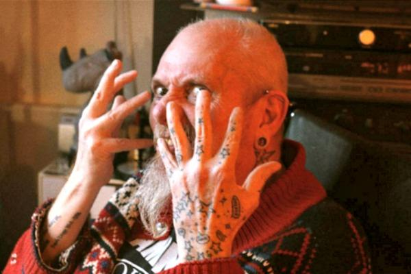 Man with heavily inked hands.