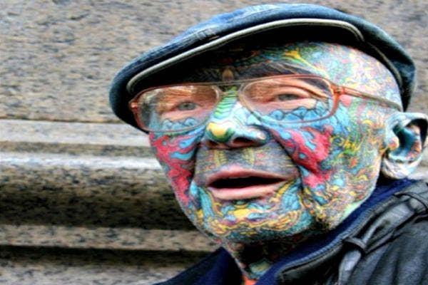 Man with facial tattoos.