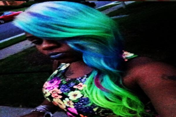 Woman with sea colored neon hair.