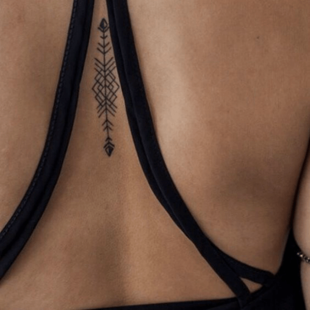 592c23b9a43cc This geometric tattoo is eye-catching and simple, but still has a lot of  detail to be simply unique. This one is in the middle of her back, ...