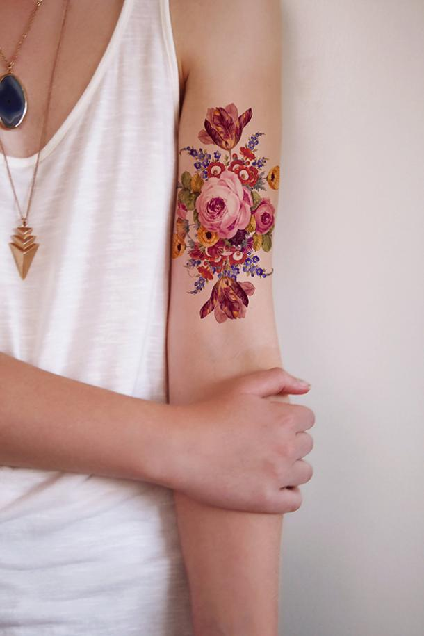 2d66c6d76 A colorful assortment of flowers that is more elegant and chic than the  other colorful wildflowers tattoos. The colors of this floral tat give it a  retro ...
