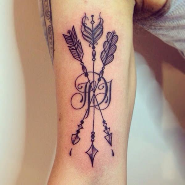 What S The Arrow Tattoo Meaning Plus 47 Cool Arrow Tattoo Ideas Yourtango Arrows may have plenty of meaning, but a bow is not complete without its arrow. what s the arrow tattoo meaning plus