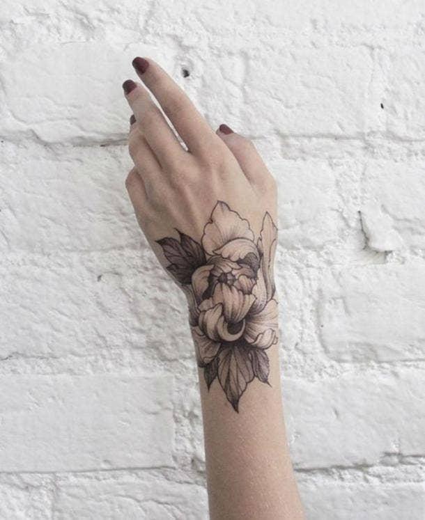 21. Flower petal design on wrist