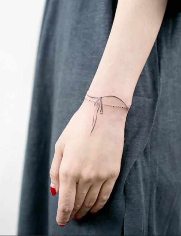 fbf21898f 50 Simple Tattoo Ideas & Designs For Women | YourTango