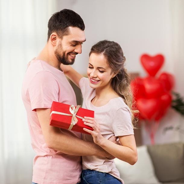 woman holding valentines gift
