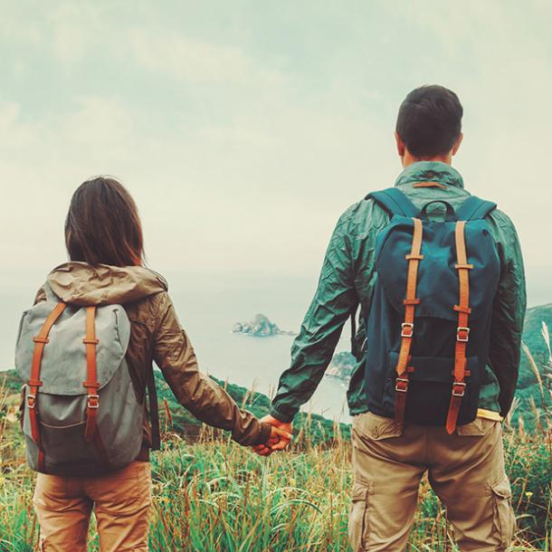 couple hiking and holding hands