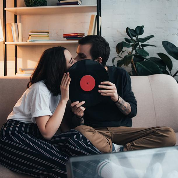 couple kissing behind a record