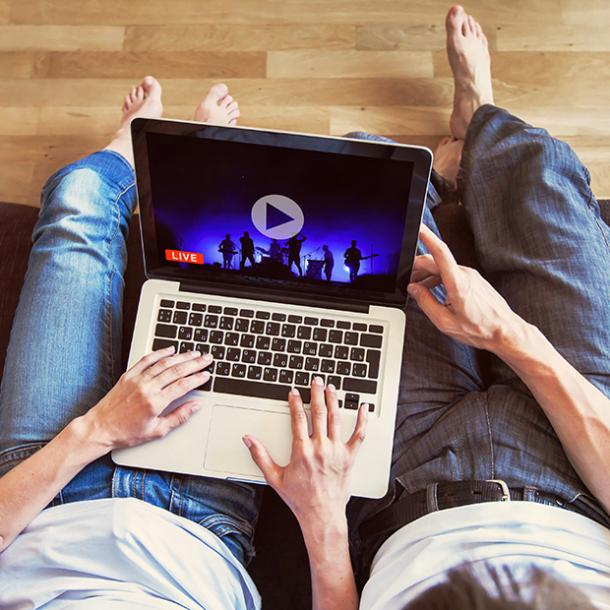 couple watching concert on a computer