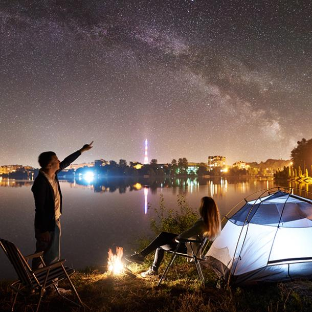 couple camping under the stars