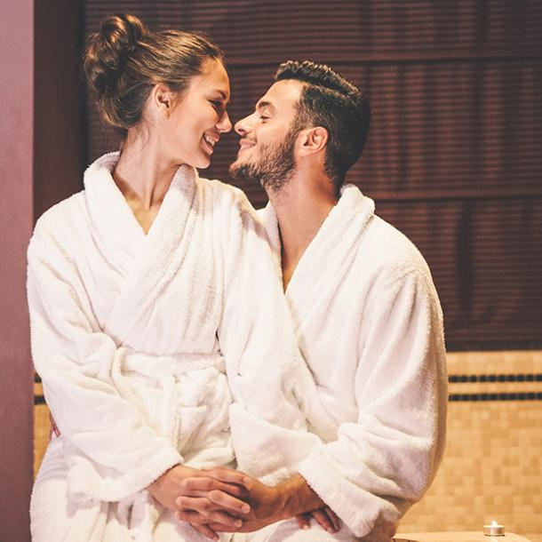 couple smiling in bathrobes