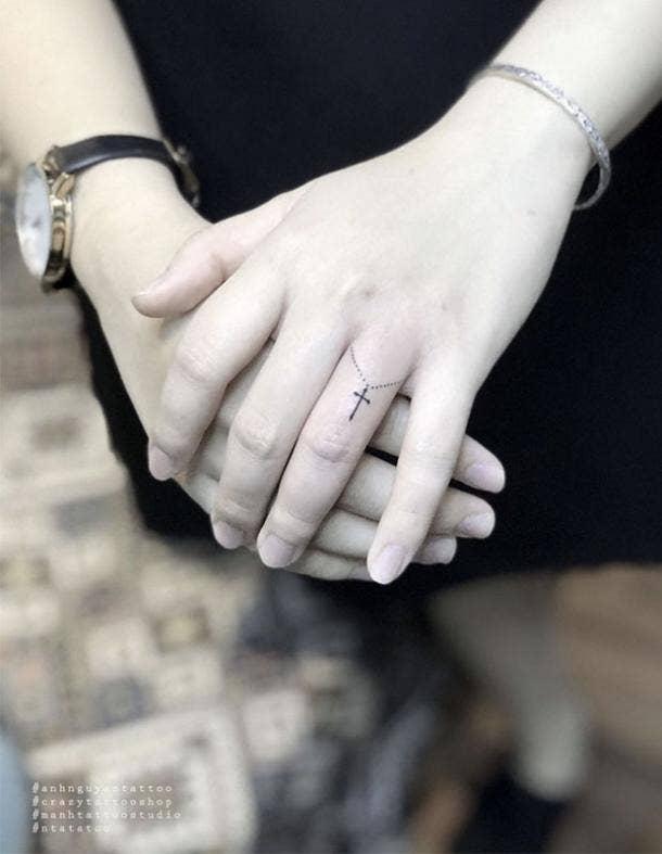 Christian wedding ring tattoo