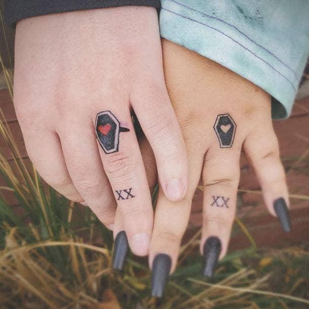 Coffin wedding ring tattoo