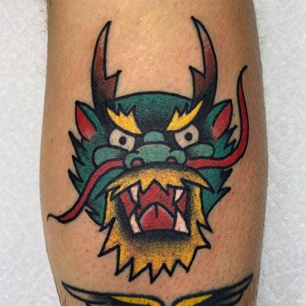 Dragon face tattoo