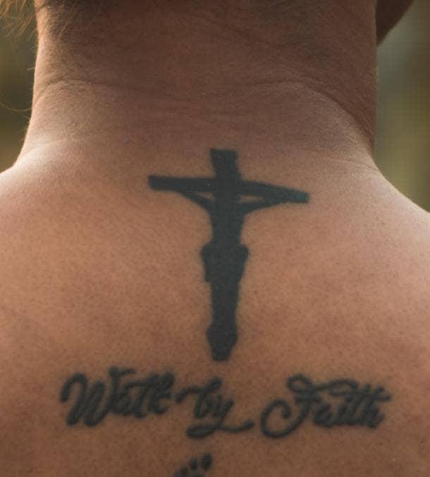 cross tattoo idea for women
