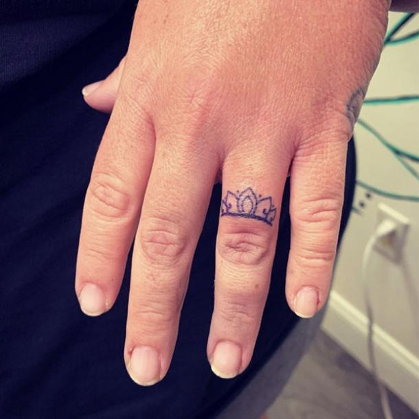 Crown wedding ring tattoo