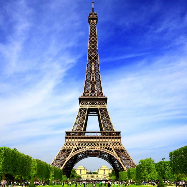 Visitors view the Eiffel Tower from up close