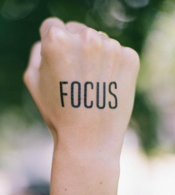 focus tattoo idea for women
