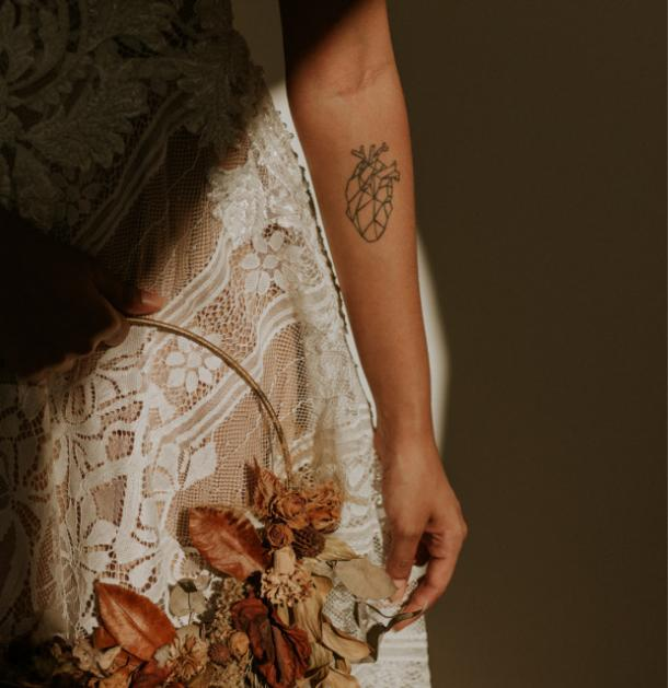 geometric heart tattoo idea for women