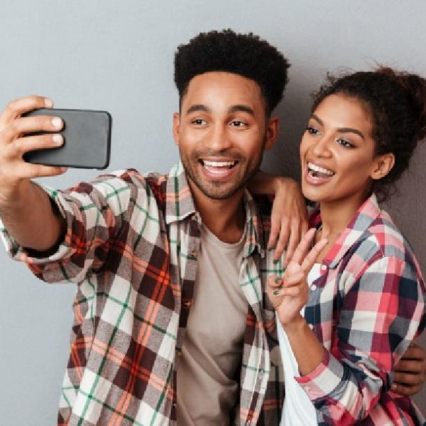 guy taking selfie with girl he likes