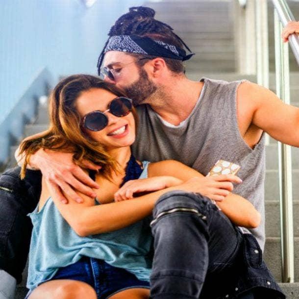 hopeful romantic couple, man kissing woman's ear