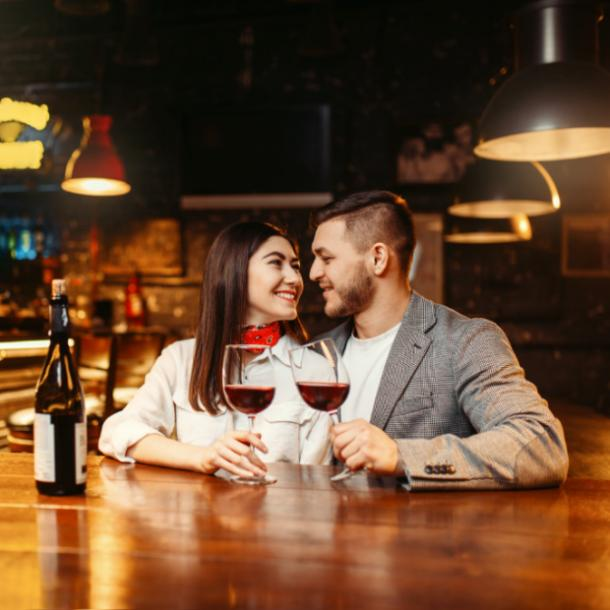 how many dates before relationship couple clinking wine glasses on a date
