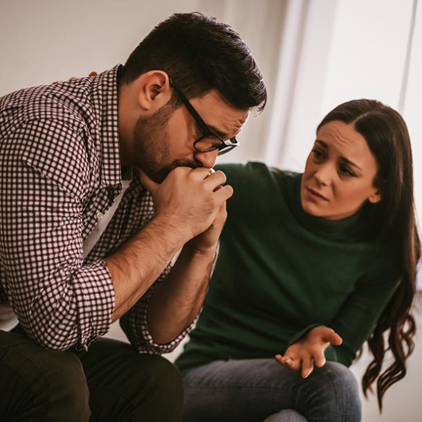 getting over infidelity man with glasses talking to woman arguing couple