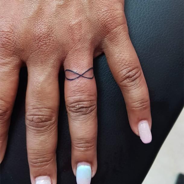 infinity sign wedding ring tattoo
