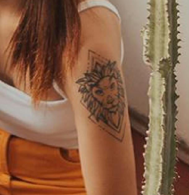 lion tattoo idea for women