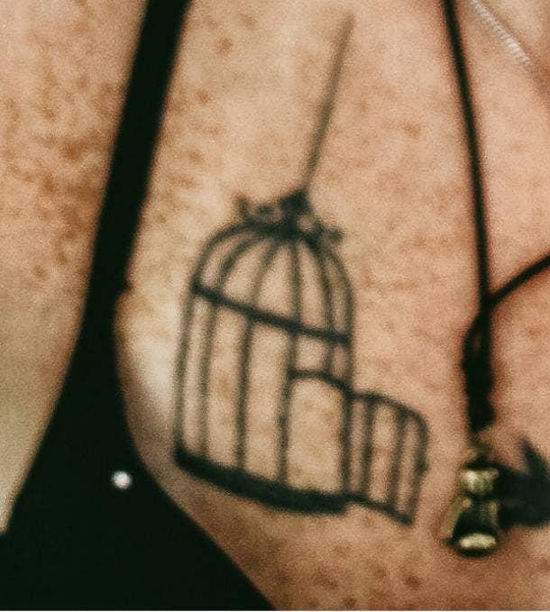 open bird cage tattoo idea for women
