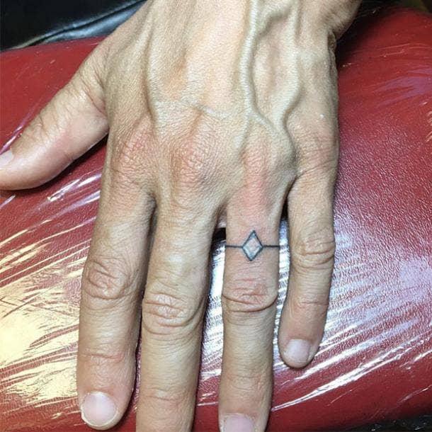 Realistic wedding ring tattoo