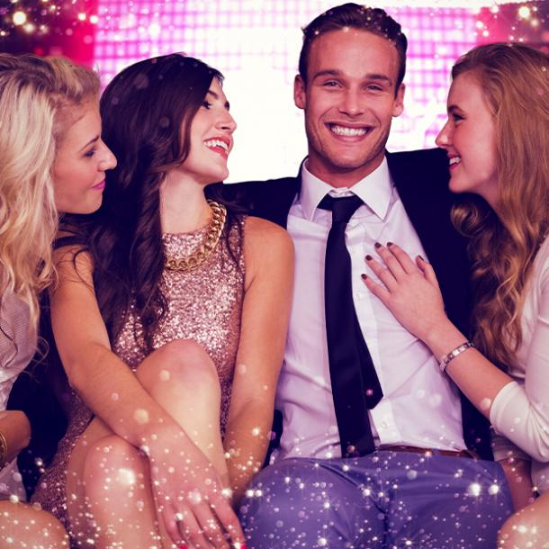 signs your ex is pretending to be over you man surrounded by women smiling
