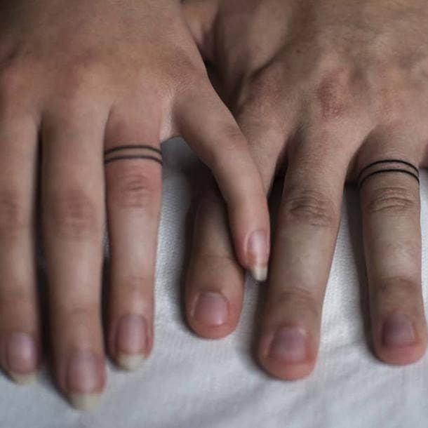 simple band wedding ring tattoo