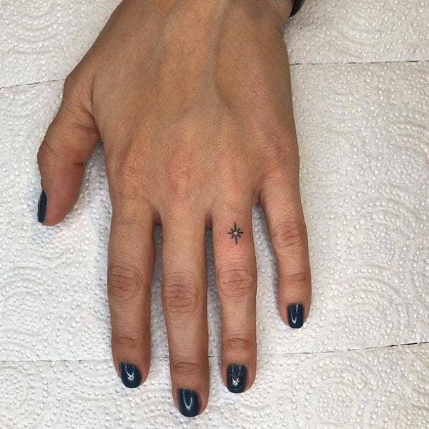 simple star wedding ring tattoo