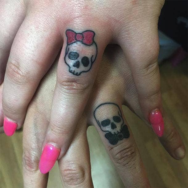 skull wedding ring tattoo