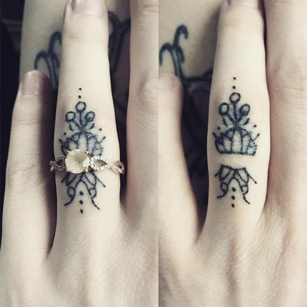 Tattoo wedding ring under a real ring