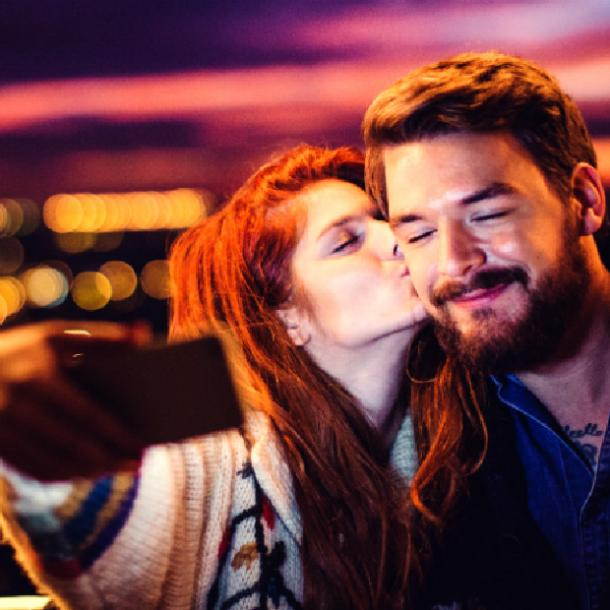 things girls do guys love - bragging about him on social media
