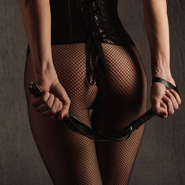 woman in lingerie spanking women