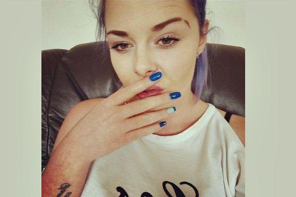 Woman with blue nails.