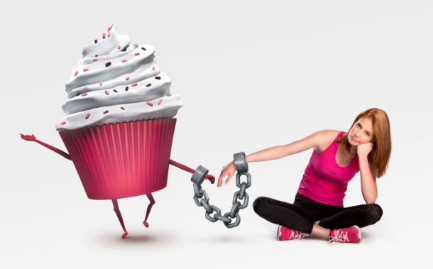 Woman chained to cupcake