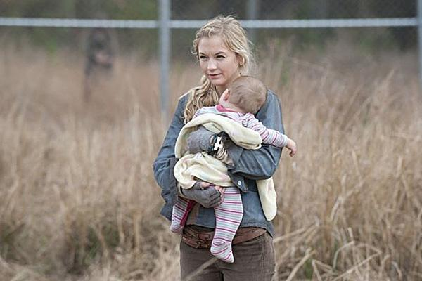Emily Kinney as Beth Greene on AMC 'The Walking Dead' holding baby Judith in a field