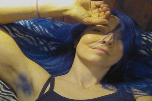 Woman with blue armpit and head hair.