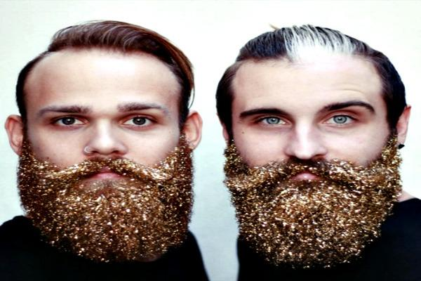 Two men with glitter in their beards.