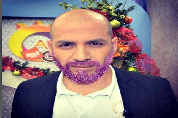 Bald man with purple glitter beard.