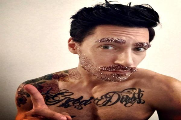 Man with ink and Glitter Beard.