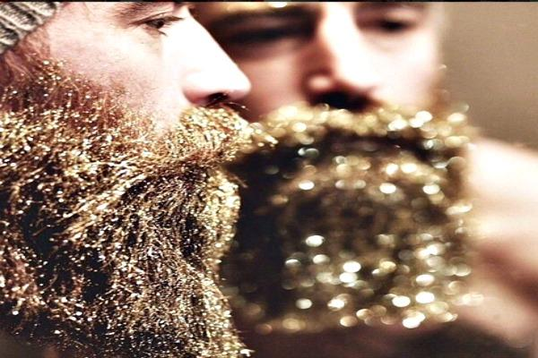 Two men with glitter beards, one in profile.
