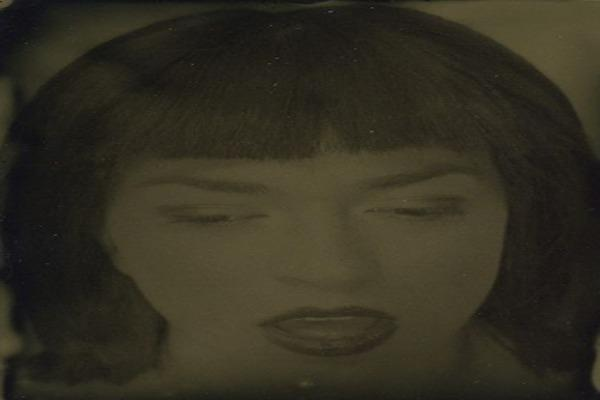 Dark haired woman with bangs