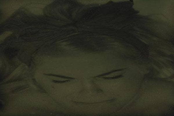 Woman eyes closed, head down